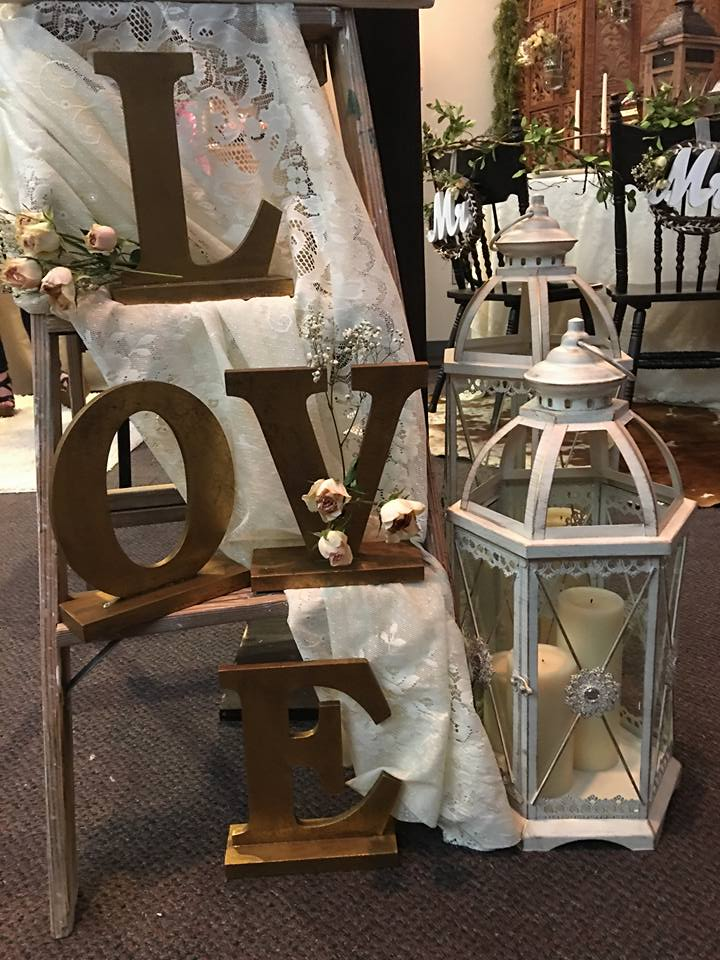 Rustic ladder with lace decorations & lanterns