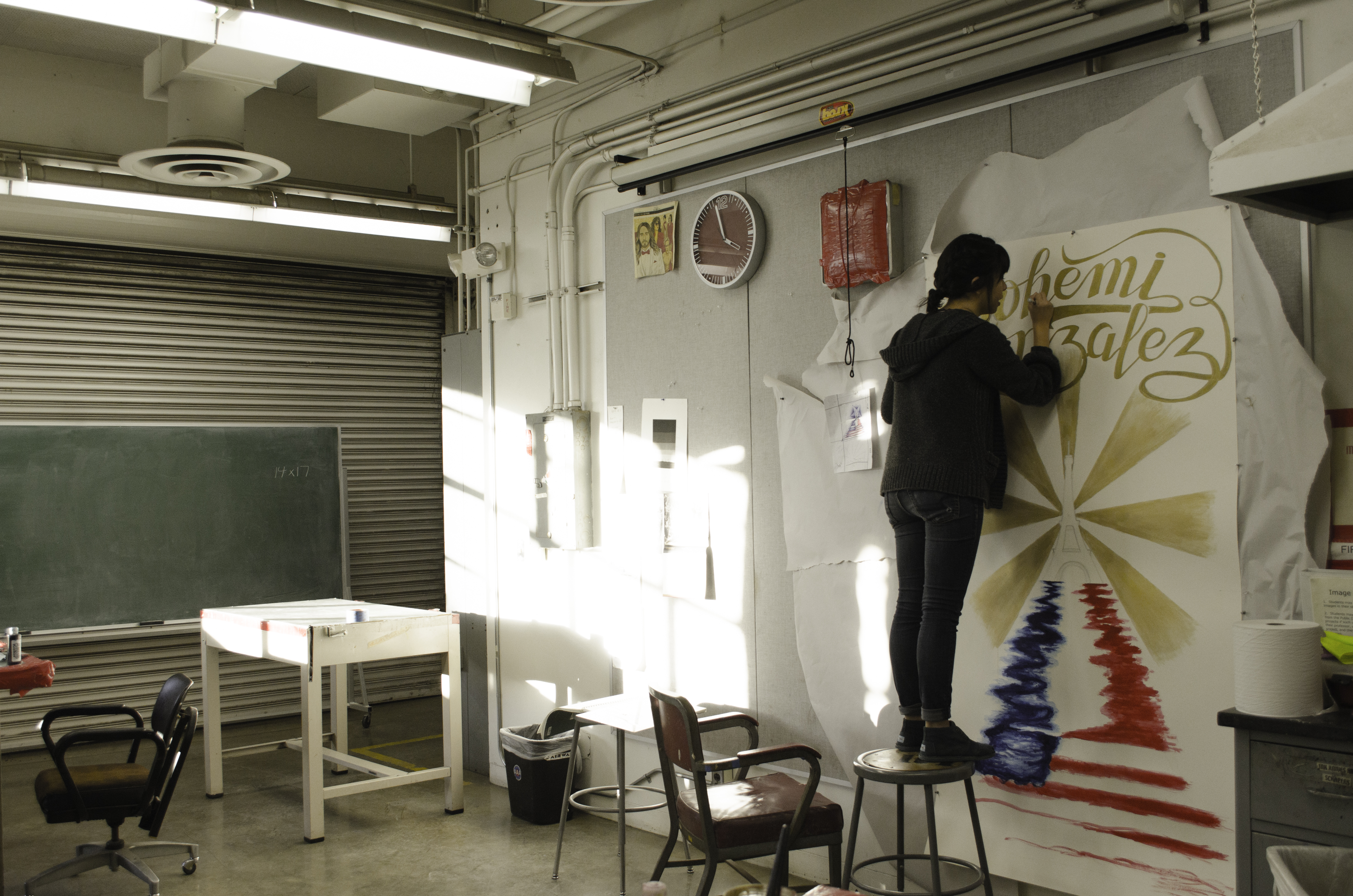 Jocelyn working on hand lettering on fine art piece which was utilized for a signed poster.